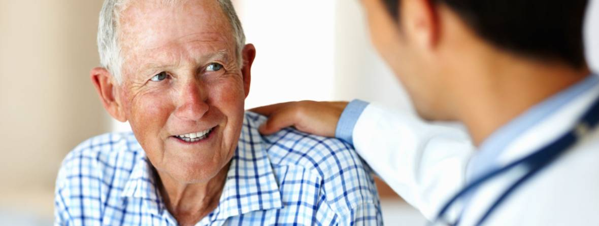 Elderly man visiting with doctor
